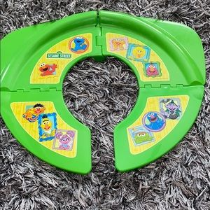Portable Sesame Street potty seat never used.